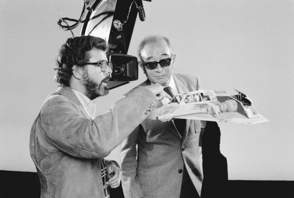 George Lucas showing legendary director Akira Kurosawa details on a Snowspeeder