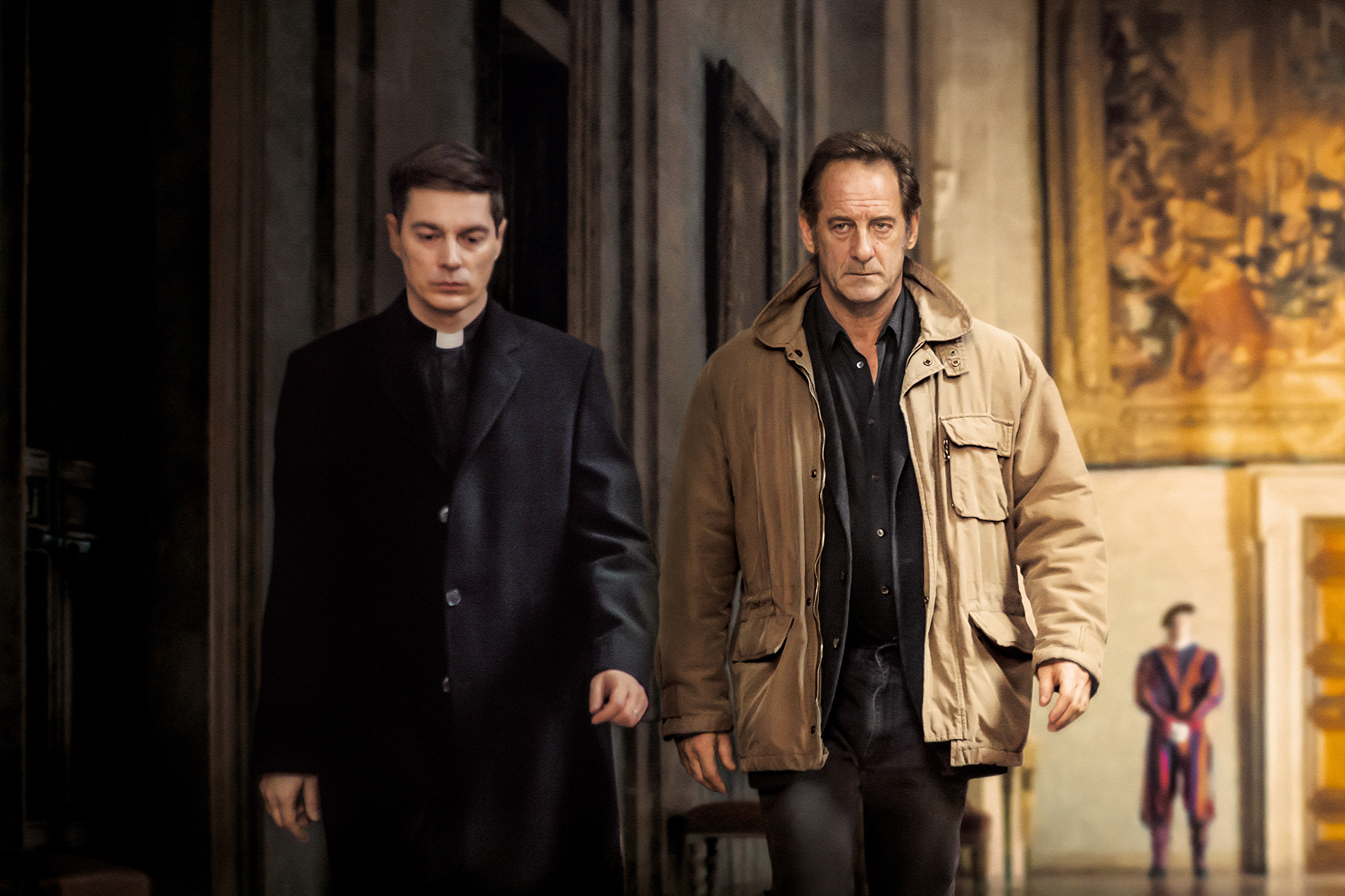 Vincent Lindon and a priest in The Apparition